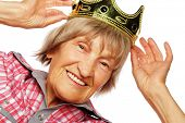 picture of crown  - Senior woman wearing crown doing funky action isolated on white background  - JPG