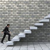 image of climbing wall  - Concept or conceptual 3D male businessman on stair or steps near a wall background - JPG