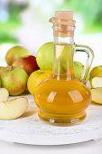 pic of cider apples  - Apple cider vinegar in glass bottle and ripe fresh apples - JPG