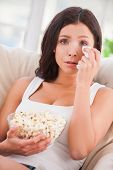 picture of watching movie  - Beautiful young woman holding handkerchief and crying while watching movie - JPG