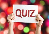 stock photo of quiz  - Quiz card with colorful background with defocused lights - JPG