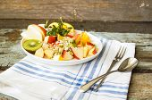 foto of oats  - Oat flakes and fruit salad on wooden table - JPG