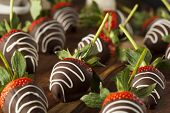 stock photo of dipping  - Homemade Chocolate Dipped Strawberries Ready to Eat - JPG