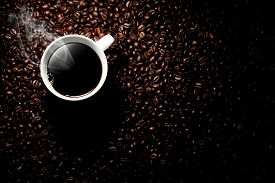 stock photo of steam  - a coffee background with a cup of coffee and coffee beans - JPG