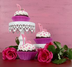 pic of stiletto  - International Womens Day March 8 cupcakes with high heel stiletto fondant shoes on vintage pink wood background on cake stands with roses. ** Note: Soft Focus at 100%, best at smaller sizes - JPG