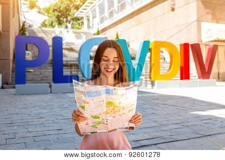Woman on colorful letters background in Plovdiv