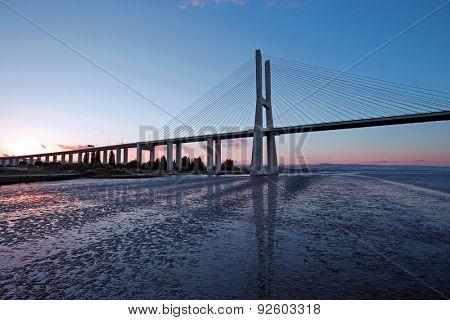 Vasco da Gama Bridge at sunset in Lisbon Portugal