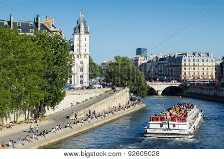 Crowd Of People On The Banks Of River Seine