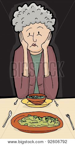 Senior Woman Having Dinner For Two