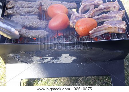 Kabobs,Lamb chops and Tomatoes on a charcoal grill