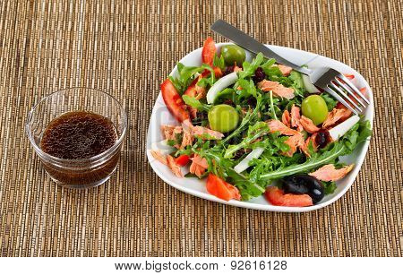 Fresh Healthy Salad And Dressing On Natural Bamboo Place Mat