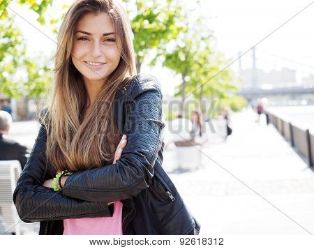 Portrait of pretty young woman. Looking at the Camera.
