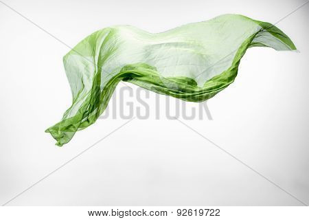 piece of green fabric flying, high speed studio shot, design element