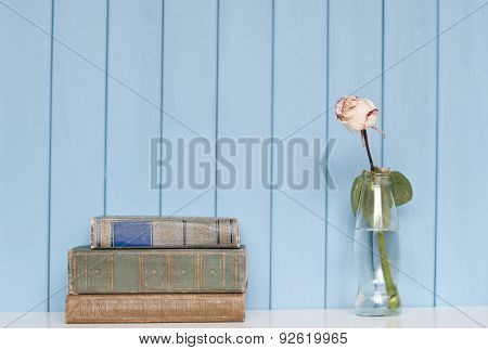 Books Pile And White Rose In The Bottle