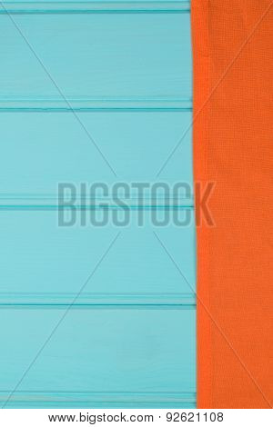 Orange Towel Over Wooden Table
