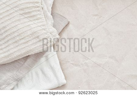 Knitting Clothes On Craft Paper