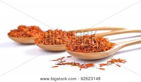 Safflower Petals In A Spoon On White Background