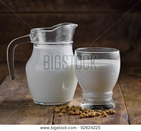 Milk And Soy In A Glass On Wooden