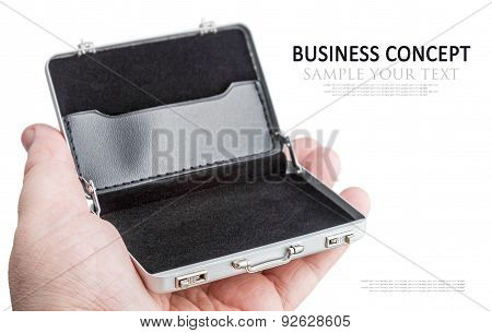 Hand Holds A Small Aluminum Case