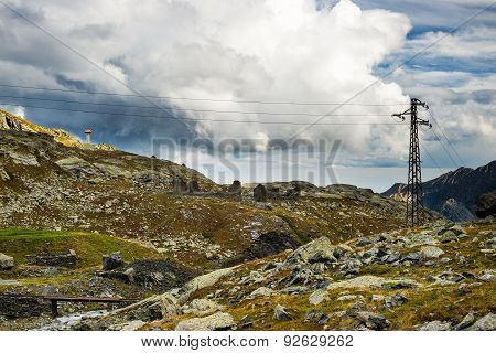 Electric Power In The Alps With Dramatic Sky