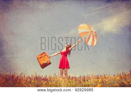 Girl In Red Dress With Umbrella And Suitcase