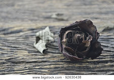Dried Rose On Wooden Background, Broken Heart Concept