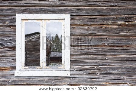 Look through a window on a wooden wall, building.