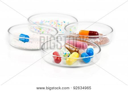 Colorful Medical Capsules In Petri Dishes