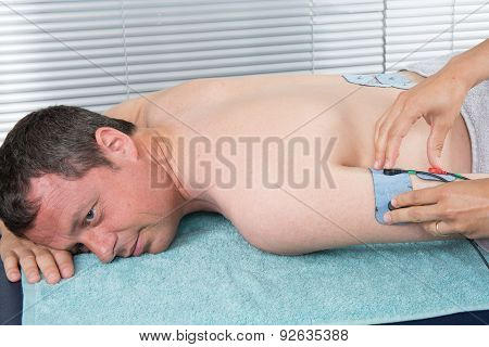 Man With Electrostimulator Electrodes On His Arm