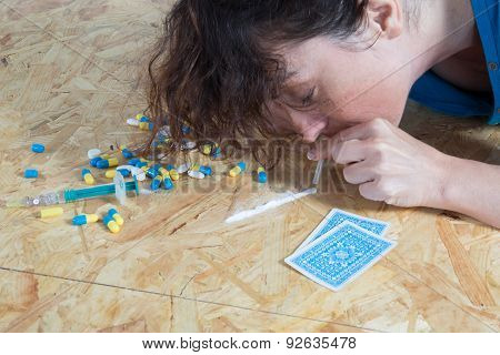 Close-up Of Drug Addicted Woman Taking Cocaine
