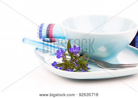 Tableware With Blue Lobelia Flowers And Cutlery,