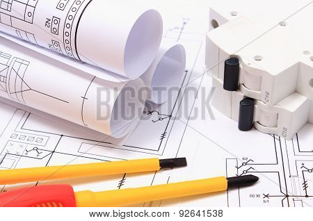 Screwdriver, Rolls Of Diagrams And Electric Fuse On Construction Drawing
