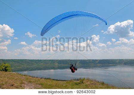 Paraglider Above Bakota Beautiful Reservoir In The Clouds