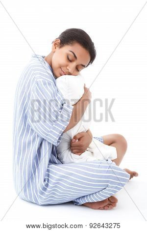 Pretty sleeping mulatto girl hugging