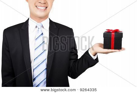 smiling businessman with gift