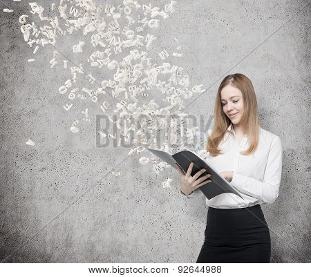 A Business Lady In A White Shirt With A Black Folder. Concrete Background And Flying Out Letters Fro