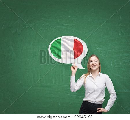 Beautiful Woman Is Pointing Out The Thought Bubble With Italian Flag. Green Background.
