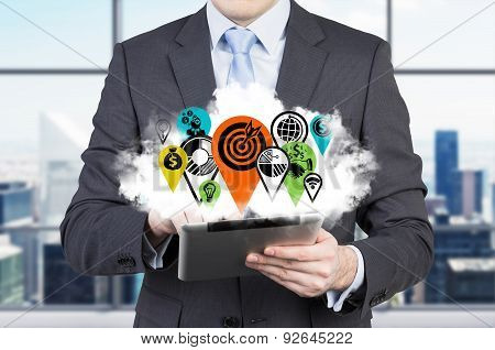 Businessman With The Tablet And The Cloud With Business Icon Flags As A Concept Of International Con