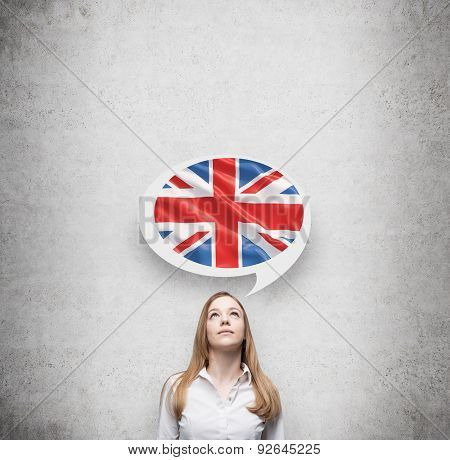 Beautiful Woman And The Thought Bubble Above The Head With Great Britain Flag. Concrete Background.