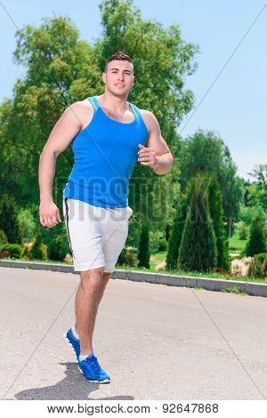 Handsome sportsman during running