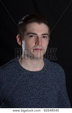 Young Caucasian Man On Black