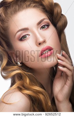 Beautiful girl with a light Nude make-up and blond hair. Beauty face.