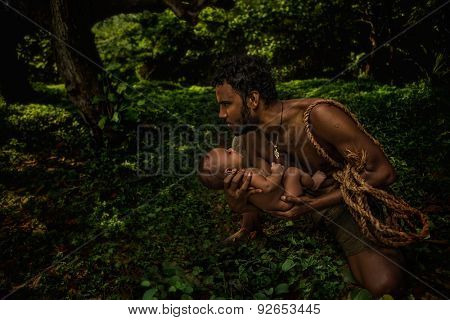 Father holding newborn baby by hands