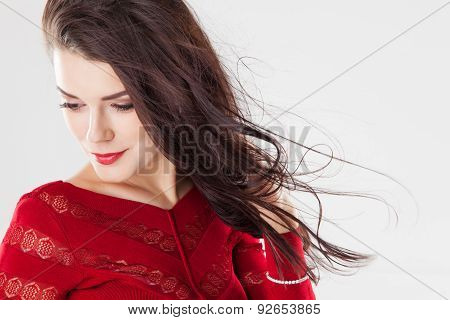 Fashion Brunette Woman With Long Hair Fluttering In The Wind