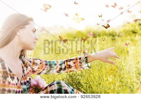Girl Sitting In A Meadow In A Swarm Of Flitting Butterflies.
