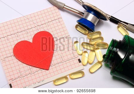 Heart Shape On Electrocardiogram Graph And Stethoscope With Tablets
