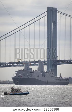 STATEN ISLAND, NY - MAY 20 2015: USS San Antonio (LPD 17) passes under the Verrazano-Narrows Bridge during the Parade of Ships, which begins Fleet Week.