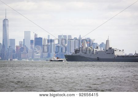 STATEN ISLAND, NY - MAY 20 2015: USS San Antonio (LPD 17) on the Hudson River near the Freedom Tower of One World Trade Center in Lower Manhattan during the Parade of Ships, which begins Fleet Week.