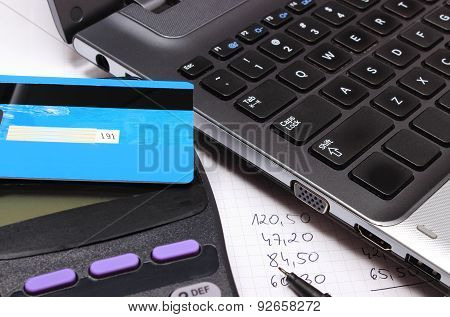 Payment Terminal With Contactless Credit Card, Laptop And Financial Calculations
