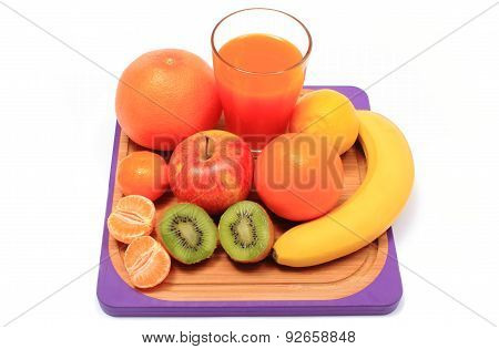 Fresh Natural Fruits And Glass Of Juice On Cutting Board